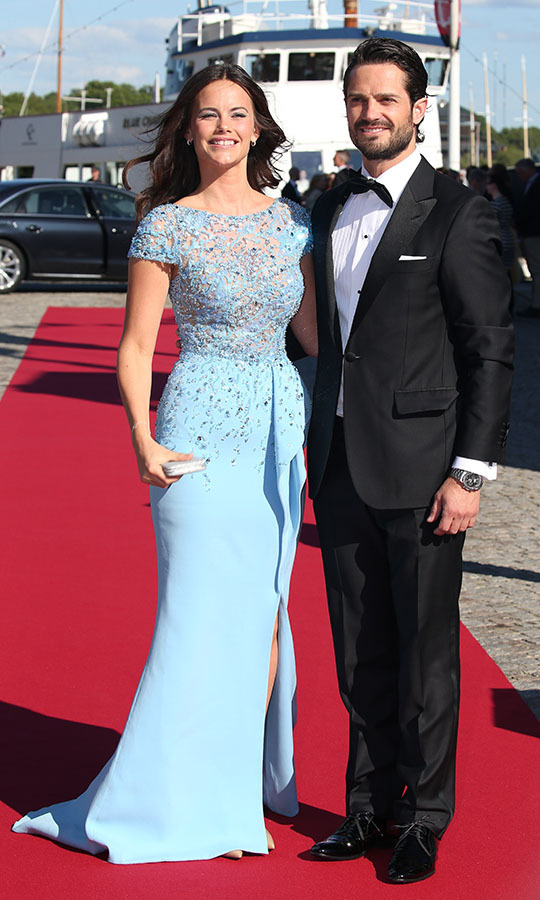 "You could say that Sofia wore her ""something blue"" to her and Prince Carl Philip's pre-wedding dinner on June 12, 2015 in Stockholm, Sweden. The bride was clad in a <a href=""https://ca.hellomagazine.com/royalty/02015061216836/prince-carl-philip-and-sofia-hellqvist-start-celebrations-for-their-royal-wedding""><strong>short-sleeved <strong>Zuhair Murad</strong> gown</a></strong>.<p>Photo: © Gisela Schober/Getty Image"