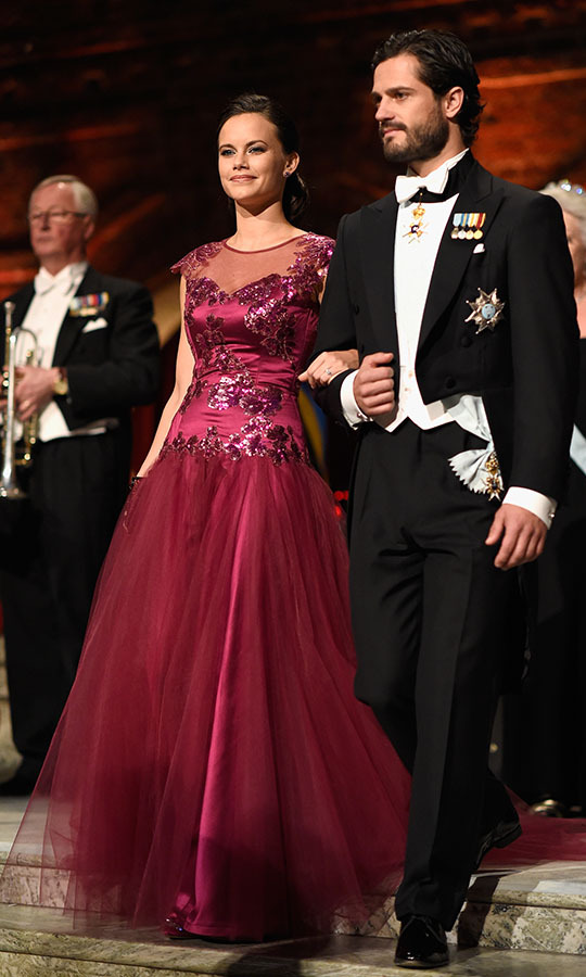 Sofia and Prince Carl Philip were one dapper duo at the Nobel Prize Banquet on Dec. 10, 2014. She looked resplendent in a raspberry gown decorated with shimmering embellishment and a full tulle skirt.<p>Photo: © Pascal Le Segretain/Getty Images