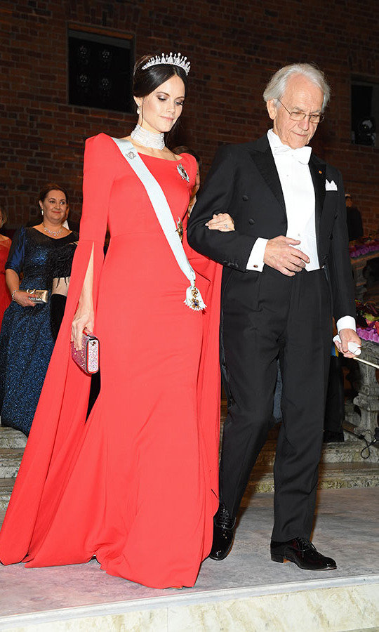 "At the Nobel Prize Banquet on Dec. 10, 2018, Sofia made jaws drop with her red gown with puffed sleeves. She wore the <strong><a href=""https://ca.hellomagazine.com/fashion/02018121048971/princess-victoria-princess-sofia-tiaras-nobel-2018/"">tiara from her wedding day</a></strong>, but the original emeralds have been replaced with pearls. The new jewels complemented her multi-strand choker perfectly! 