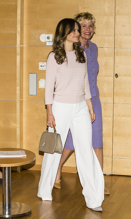 Princess Sofia of Sweden lightened up for summer in crisp white pants and a textured knit top at a symposium for Recovery From Anorexia at Sophiahemmet University on June 3, 2019.<p>Photo: © Michael Campanella/Getty Images
