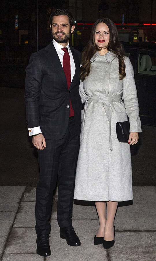 "Prince Carl Phillip and Princess Sofia both added festive touches to their outfits at  the ""Christmas in Vasastan"" concert at Gustav Vasa church on Dec. 21, 2017 in Stockholm. The former reality TV star punctuated her grey coat with red lipstick.<p>Photo: © MICHAEL CAMPANELLA/GC Images"