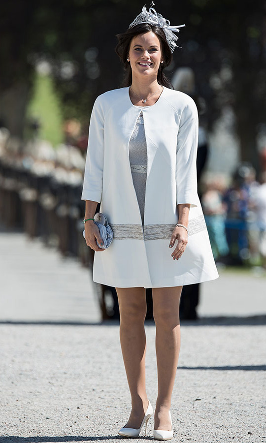 "The Swedish beauty radiated in white at the Royal Christening for <strong><a href=""https://ca.hellomagazine.com/tags/0/princess-leonore"" target=""_blank"">Princess Leonore</a></strong> at Drottningholm Palace Chapel on June 8, 2014. Her pristine white coat had a subtle A-line shape and was trimmed with a textured band. A bow-adorned fascinator and silver-blue clutch finished the outfit.<p>Photo: © Anna Lu Lundholm/WireImage"