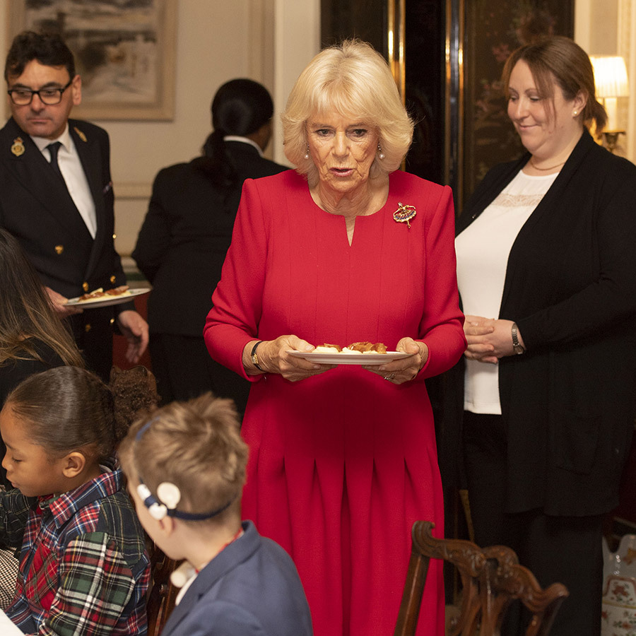 When it was time for lunch, Camilla got right into helping, bringing plates of food to the table for the kids. We know for sure from Santa, who emailed us, that they're all at the top of his Nice List this year.