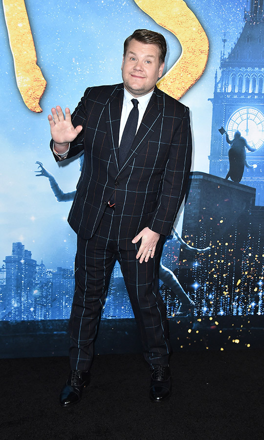 <a href=/tags/0/james-corden><strong>James Corden</a></strong> was his usual jokey, friendly self, wearing a blue-and-white plaid suit.