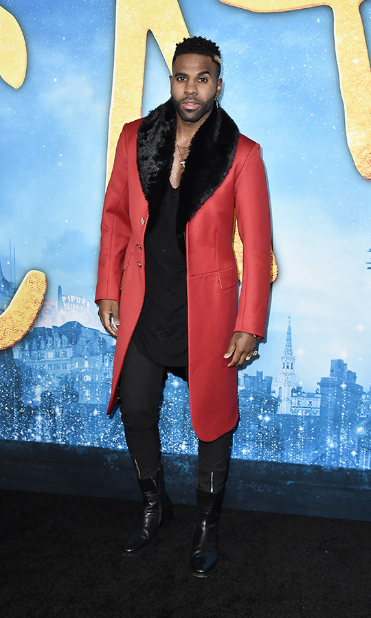 <a href=/tags/0/jason-derulo><strong>Jason Derulo</a></strong> kept warm with a bright red coat with black fur lining overtop of an all-black look.