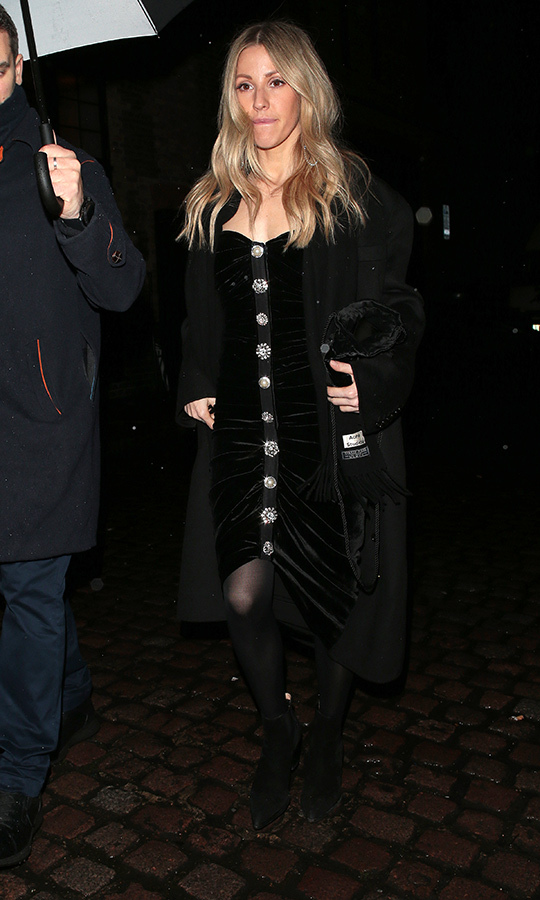 Singer <strong><A href=/tags/0/ellie-goulding>Ellie Goulding</a></strong>, who is one of Beatrice's best friends, wore a black velvet dress with buttons down the front.