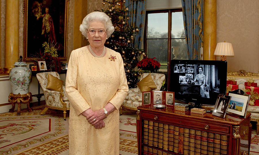<h2>2007</h2></p><p>To mark the 50th anniversary of her first televised Christmas speech, the Queen posed next to the recording at Buckingham Palace. Her gold dress with sprinkling of embellishment was joyful and complemented her surroundings.</p><p>Photo: © Pool/Anwar Hussein Collection/WireImage
