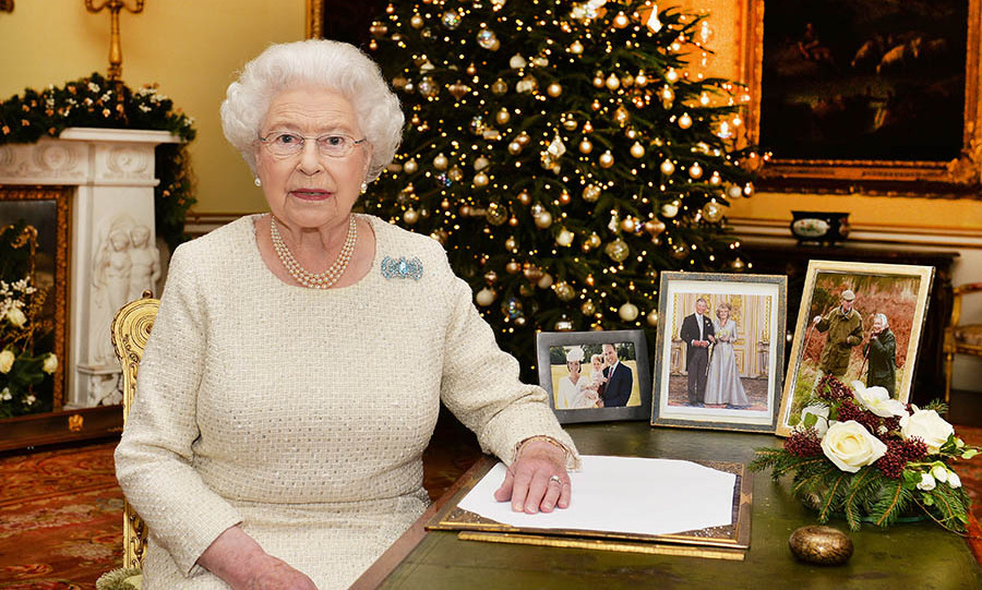 "<h2>2015</h2></p><p>Surrounded by family portraits on her desk in the 18th Century Room at Buckingham Palace, the Queen looked lovely in a pale textured dress. The subdued colour emphasized her Art Deco diamond and aquamarine brooch, which was previously owned by <a href=""https://ca.hellomagazine.com/tags/0/queen-mother/"" target=""_blank"">the <strong>Queen Mother</strong></a>.</p><p>Photo: © John Stillwell-WPA Pool/Getty Images"