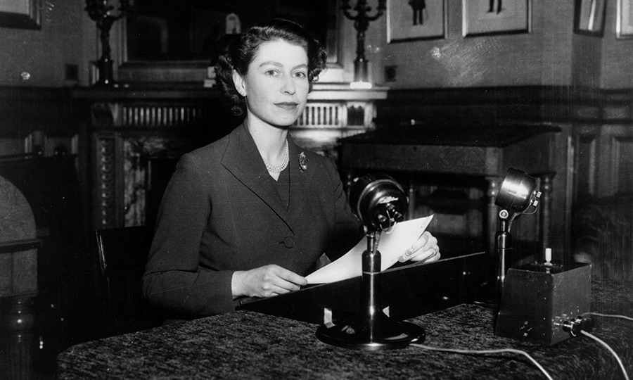 "<h2>1952</h2><p>At 26 years old, the Queen gave her first-ever Christmas broadcast to the nation from  <a href=""https://ca.hellomagazine.com/tags/0/Sandringham"" target=""_blank""><strong>Sandringham</strong></a> in Norfolk via radio. The elegant photo shows she has always favoured pearl necklaces and elegant silhouettes!<p>Photo: © Fox Photos/Getty Images"