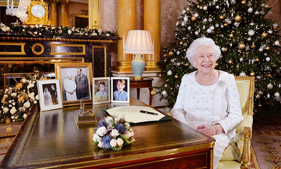 <h2>2017</h2></p><p>'Tis the season for some shimmer! Her Majesty sat at her desk in the 1844 Room at Buckingham Palace, after recording her Christmas Day broadcast. She wore an embellished white dress with a diamond brooch.</p><p>Photo: © John Stillwell - WPA Pool/ Getty Images