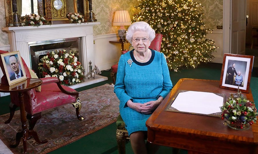 <h2>2016</h2></p><p>In the Regency Room at Buckingham Palace, Her Majesty looked lovely for her 2016 Christmas message in a blue textured dress with contrasting neckline and pearl jewelry.</p><p>Photo: © Yui Mok - WPA Pool/Getty Images