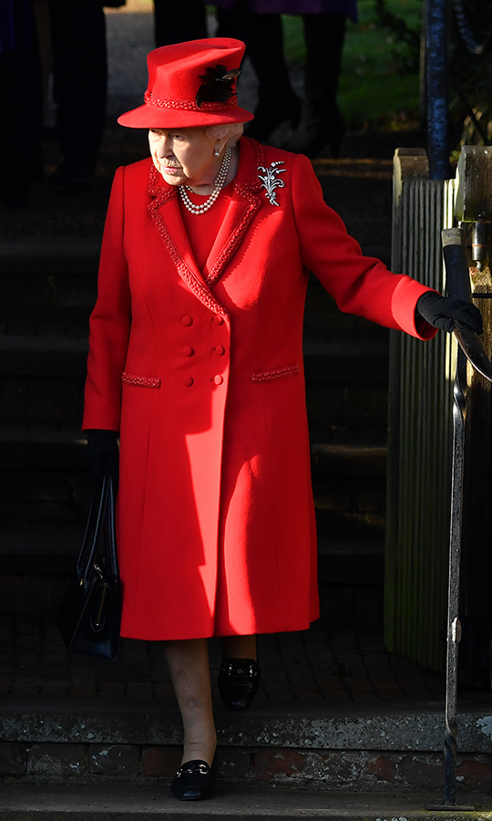 How festive did <a href=/tags/0/queen-elizabeth-ii><Strong>the Queen</a></strong> look? Her Majesty wowed in a very seasonally-appropriate scarlet red ensemble.
