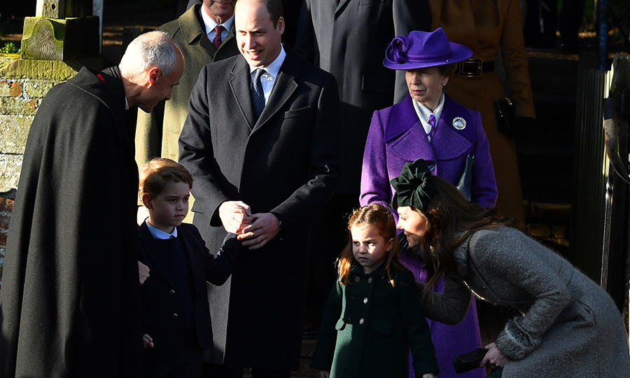 Kate bent down to reassure her daughter after church had finished.