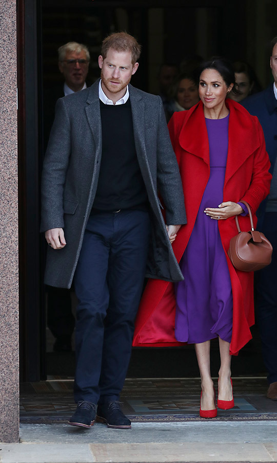 "<h2>Birkenhead, Jan. 14</h2></p><p>Duchess Meghan had a colourful start to the year with a striking midi dress by Canadian label <strong><a href=""https://ca.hellomagazine.com/tags/0/aritzia/"">Babaton by Aritzia</a></strong> paired with a bright red <a href=""https://ca.hellomagazine.com/tags/0/sentaler/""><strong>Sentaler</strong></a> coat and matching heels.</p><p>Photo: © Neil Mockford/GC Images"