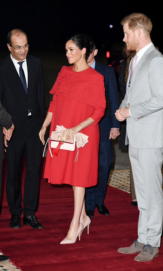 "<h2>Casablanca, Feb. 23</h2></p><p>Talk about a grand arrival! Meghan looked as chic as can be at Casablanca airport for the beginning of the couple's royal tour. There was no missing her in this bright red <strong><a href=""https://ca.hellomagazine.com/tags/0/valentino"">Valentino</a></strong> gown with cape detail.</p><p>Photo: © Pool/Samir Hussein/WireImage"