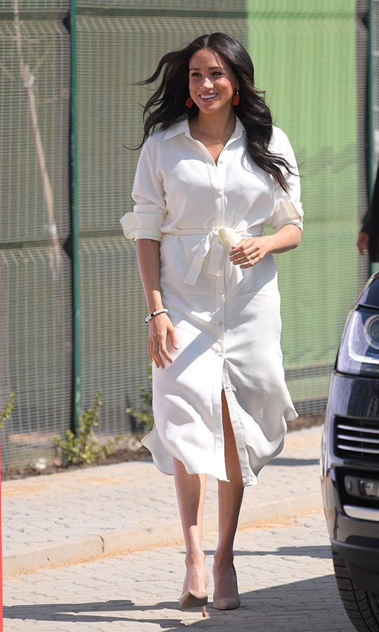 "<h2>Johannesburg, Oct. 2</h2></p><p>Duchess Meghan's South African royal tour wardrobe featured one fantastic look after another. In Johannesburg on Oct. 2, <a href=""https://ca.hellomagazine.com/fashion/02019100253226/meghan-markle-johannesburg-south-africa-white-shirt-dress/""><Strong>she wore an elegant ivory belted dress</strong></a> to visit the Tembisa Township to learn about its youth employment services. The chic look was by local ethical fashion brand <a href=""https://ca.hellomagazine.com/tags/0/hannah-lavery/""><strong>Hannah Lavery</strong></a>.</p><p>Photo: © Karwai Tang/WireImage"