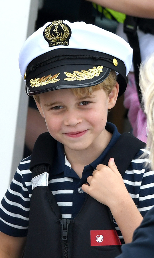 George made everyone smile when he and Charlotte appeared on a boat to watch their parents compete in the inaugural King's Cup Regatta in August. The eldest Prince of Cambridge looked adorable in a very appropriately nautical top and captain hat!