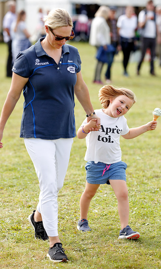 <a href=/tags/0/mia-tindall><strong>Mia Tindall</a></strong> gave the cameras a smile while enjoying an ice cream at the Whatley Manor Gatcombe International Horse Trials at Gatcombe Park on Sept. 15 in Stroud, England. 