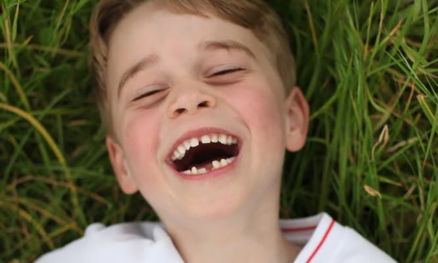 Duchess Kate released three portraits taken for George's sixth birthday in July, including this sweet one of the prince in huge giggles while lying outdoors.