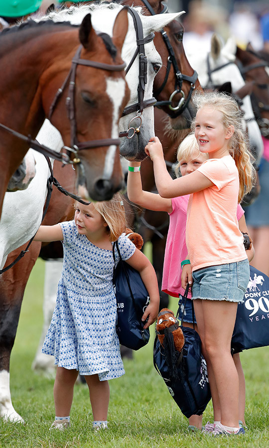 The girls, who are all <strong><a href=/tags/0/princess-anne>Princess Anne</a></strong>'s grandchildren, couldn't wait to say hello to some horses at the same event.