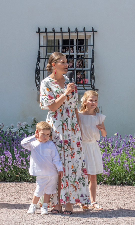So sweet! <strong><a href=/tags/0/prince-oscar>Prince Oscar</a></strong> and Princess Estelle stuck close by their mom, Sweden's <strong><a href=/tags/0/crown-princess-victoria>Crown Princess Victoria</a></strong>, as she addressed a crowd at her 42nd birthday celebration on July 14. 