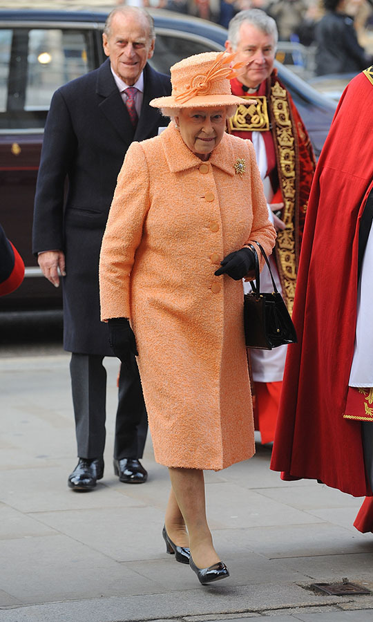 <h2>London, 2010</h2></p><p>This sherbet orange hat and coat were elegant and joyful at the same time. The subtle textured fabric brought another dimension to the look. The Queen sported the ensemble at the ninth inauguration of the General Synod at Westminster Abbey on Nov. 23.<p>Photo: © Ferdaus Shamim/WireImage