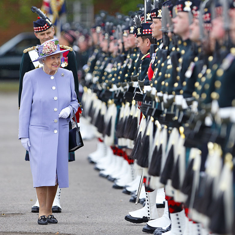 <h2>Canterbury, 2013</h2></p><p>Lovely in lilac! The Queen wore the shade beautifully in a monochromatic outfit to inspect the  troops of the Argyll & Sutherland Highlanders, 5th Battalion, Royal Regiment of Scotland during a visit to Howe Barracks in Canterbury, England on June 28. The contrasting flowers in her hat were a spirited choice.<p>Photo: © Max Mumby/Indigo/Getty Images