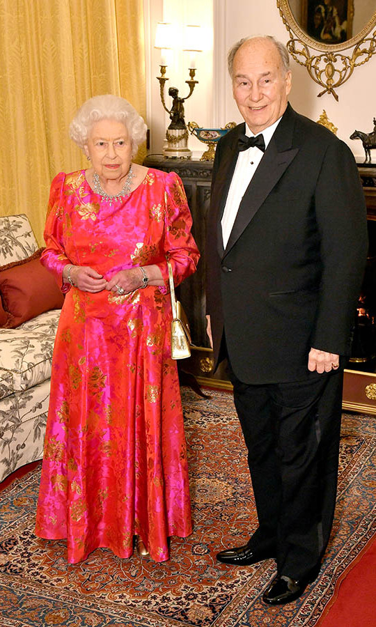 <h2>Windsor Castle, 2018</h2></p><p>Queen Elizabeth II was a vision in shades of red and pink at a private dinner at Windsor Castle on March 8. She traded her typical black handbag for a gold version to highlight the leaf design in her dress to dazzling effect!<p>Photo: © Dominic Lipinski-WPA Pool/Getty Images