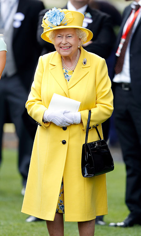<h2>Royal Ascot, 2018</h2></p><p>This cheerful yellow ensemble with blue accents will have anyone beaming as much as the Queen. The monarch sported the sunny look to watch her horse run in the Wolferton Stakes during Royal Ascot  on June 19.</p><p>Photo: © Max Mumby/Indigo/Getty Images