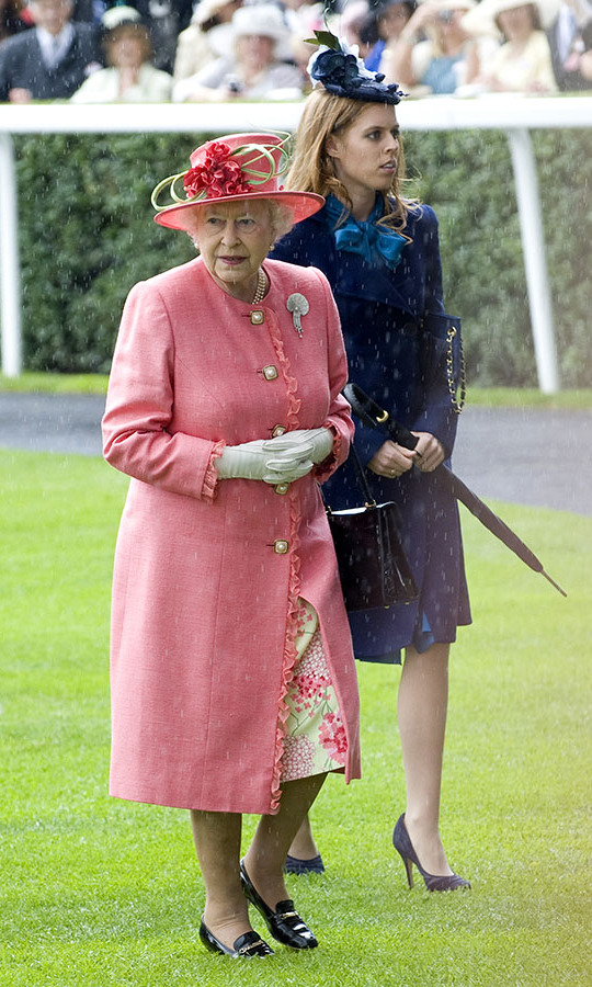 "<h2>Royal Ascot, 2011</h2></p><p>The style at <a href=""https://ca.hellomagazine.com/tags/0/royal-ascot"" target=""_blank""><strong>Royal Ascot</strong></a> is not to be missed and the Queen is the one who shines the brightest! She looked lovely in coral when she and granddaughter <a href=""https://ca.hellomagazine.com/tags/0/princess-beatrice"" target=""_blank""><strong>Princess Beatrice</strong></a> attended Ladies Day on June 16. Not even the rain could bring down her spectacular look!<p>Photo: © Samir Hussein/WireImage"