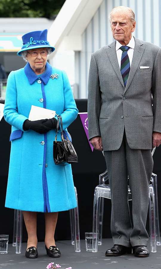 <h2>Tweedbank, 2015</h2></p><p>The Queen celebrated becoming Britain's longest reigning monarch on Sept. 9 in Tweedbank, Scotland in a striking two-tone hat and coat. The shades of aqua and azure blue looked so fresh, especially paired with her go-to accessories!<p>Photo: © Chris Jackson/Getty Images