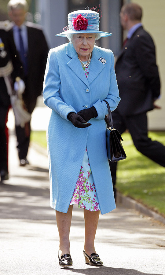 <h2>North Yorkshire, 2010</h2></p><p>The Queen's outfits grab royal fans' attention with their lively colours. Then we notice all the carefully considered details. At the Northstead Manor Gardens Open Air Theatre opening in North Yorkshire on May 20, it was the icy blue that one first notices followed by the red floral pattern and winding rose on her brimmed hat.</p><p>Photo: © Indigo/Getty Images