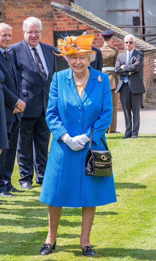 <h2>Staffordshire, 2017</h2></p><p>Two colours are better than one! The queen's vivid coat and contrasting hat at the Lower Castle Hayes farm in Staffordshire on May 25 were a striking example of harmonious colour theory. Her floral dress helped further bring the look together.<p>Photo: © Richard Stonehouse/Getty Images
