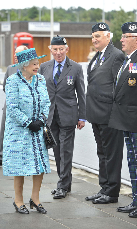 <h2>Edinburgh, 2014</h2></p><p>Every detail of Queen Elizabeth II's look is taken into consideration. For example, the lace trim on her coat accents her favourite loafers and black gloves. Furthermore, the detail helps draw attention to her face. The pale blue shade is beautiful with her light hair and complexion. She wore this outfit on July 4 to visit Forth Road Bridge in Edinburgh to mark its 50th anniversary. <p>Photo: © Phil Wilkinson - Pool /Getty Images