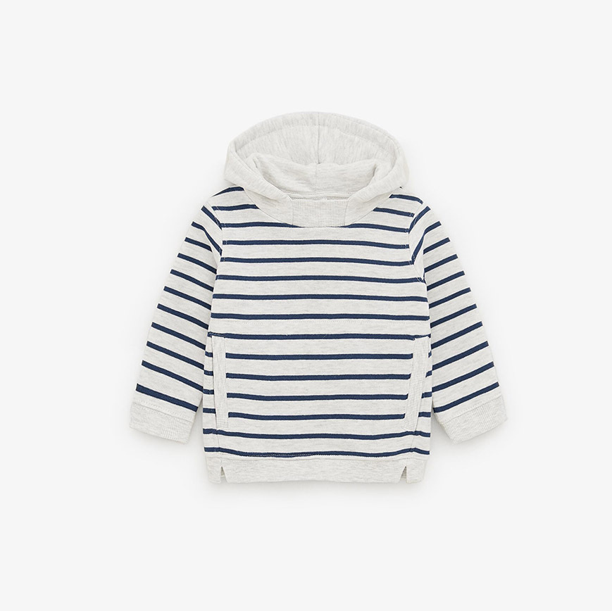 "Achieve the fun effect of the contrasting lining on Archie's jacket with a striped hoodie. This <a href=""https://ca.hellomagazine.com/tags/0/zara"" target=""_blank""><strong>Zara</strong></a> grey marl and navy version is classic. It has front pockets and a roomy hood to keep delicate ears warm.</p><p>Striped Hoodie Sweatshirt, $9.99, <a href=""https://www.zara.com/ca/en/striped-hoodie-sweatshirt-p01880565.html?v1=13679234&v2=1415743"" target=""_blank"">Zara</a></p><p>Screenshot via zara.com"