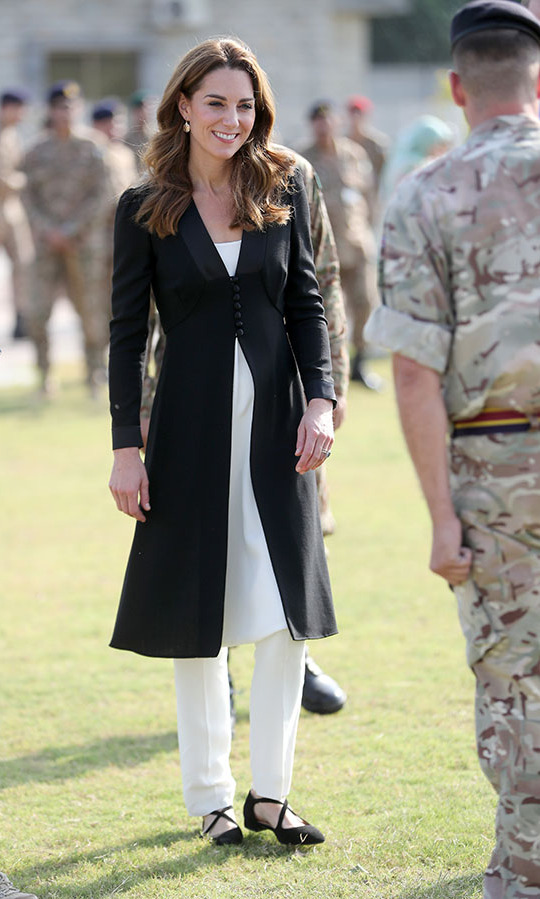 "<h2>Islamabad, Oct. 18</h2></p><p>Kate's <a href=""https://ca.hellomagazine.com/fashion/02019101853429/kate-middleton-pakistan-royal-tour-wardrobe"" target=""_blank""><strong>Pakistan royal tour wardrobe</strong></a> was filled with incredible outfits! When she visited an <a href=""https://ca.hellomagazine.com/fashion/02019101853421/kate-middleton-beulah-russell-bromley-pakistan-royal-tour"" target=""_blank""><strong>Army Canine Centre</strong></a> on Oct. 18 in Islamabad, she looked so chic in flowing white trousers with a longline black blazer coat by <strong><a href=""https://ca.hellomagazine.com/tags/0/beulah-london"">Beulah London</a></strong> and <strong><a href=""https://ca.hellomagazine.com/tags/0/russell-and-bromley"">Russell & Bromley</a></strong> flats.</p><p>Photo: © Chris Jackson - Pool/Getty Images"