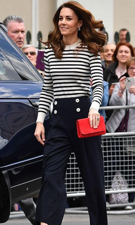 "<h2>London, May 7</h2></p><p>At the launch of the <strong><a href=""https://ca.hellomagazine.com/royalty/02019050751298/kate-middleton-nautical-wear-prince-william-excitement-royal-baby"" target=""_blank"">King's Cup Regatta at the Cutty Sark British clipper ship</a></strong> in Greenwich, London on May 7, Kate was perfectly on theme in sailor stripes. She donned a Breton-like navy and cream top with high-waisted navy sailor trousers by <strong><a href=""https://ca.hellomagazine.com/tags/0/lk-bennett/"">L.K. Bennett</a></strong>. She teamed the separates with a red clutch and navy pumps.</p><p>Photo: © Ben Stansall - WPA Pool / Getty Images"