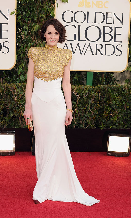 "<h2>Michelle Dockery, 2013</h2><p><strong><a href=""https://ca.hellomagazine.com/tags/0/michelle-dockery"" target=""_blank"">Michelle Dockery</a></strong> was a gilded beauty in <a href=""https://ca.hellomagazine.com/tags/0/Alexandre-Vauthier"" target=""_blank""><strong>Alexandre Vauthier</strong></a> at the 2013 Golden Globes. The <a href=""https://ca.hellomagazine.com/tags/0/downton-abbey"" target=""_blank""><strong><em>Downton Abbey</em></strong></a> actress's flowing white skirt was juxtaposed with a striking metallic gold lace bodice. The latter detail had a feeling of armour thanks to its sculptured, fitted shape.</p><p>Photo: © Steve Granitz/WireImage"