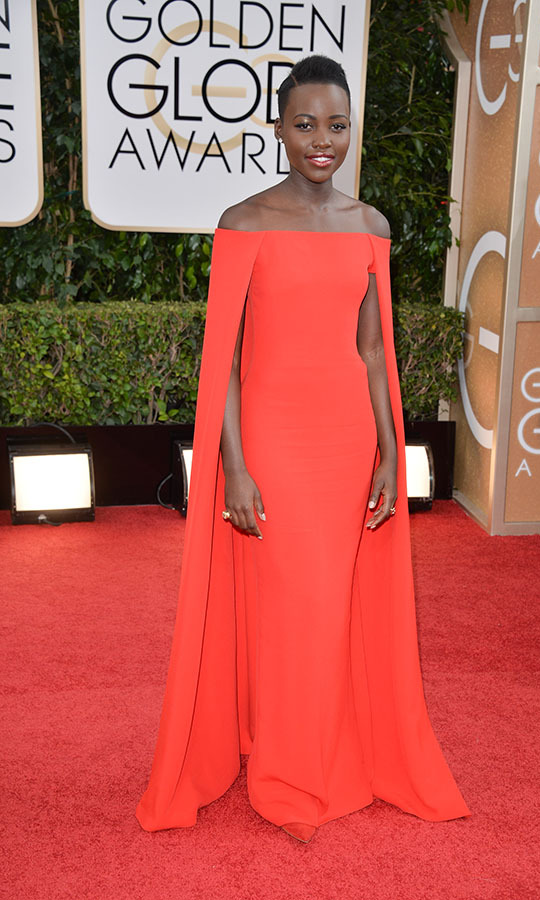 "<h2>Lupita Nyong'o, 2014</h2><p><a href=""https://ca.hellomagazine.com/tags/0/lupita-nyongo"" target=""_blank""><strong>Lupita Nyong'o</strong></a> helped ignite the cape trend in a regal red <a href=""https://ca.hellomagazine.com/tags/0/ralph-lauren"" target=""_blank""><strong>Ralph Lauren</strong></a> gown. The off-the-shoulder neckline with flowing sleeves was a seemingly simple look, but it guaranteed all eyes were on the actress.</p><p>Photo: © George Pimentel/WireImage"