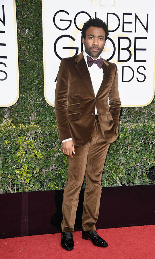 "<h2>Donald Glover, 2017</h2><p><strong><a href=""https://ca.hellomagazine.com/tags/0/donald-glover"" target=""_blank"">Donald Glover</a></strong> has a signature style that combines modern and retro elements. He deviated from the traditional black suit to great effect at the 2017 Golden Globes. He took home the Golden Globe Award for Best Actor – Television Series Musical or Comedy for <strong><em>Atlanta</em></strong> in a brown velvet <a href=""https://ca.hellomagazine.com/tags/0/gucci"" target=""_blank""><strong>Gucci</strong></a> suit with coordinating bow tie and white shirt.</p><p>Photo: © Frazer Harrison/Getty Images"