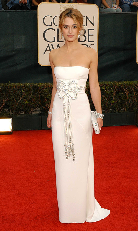 "<h2>Keira Knightley, 2006</h2><p>Gorgeous in white! <a href=""https://ca.hellomagazine.com/tags/0/keira-knightley"" target=""_blank""><strong>Keira Knightley</strong></a> shone in <a href=""https://ca.hellomagazine.com/tags/0/valentino"" target=""_blank""><strong>Valentino</strong></a> at the 2006 Golden Globes. She styled the strapless dress simply with coordinating white jewelry and a clutch so the metallic twisted waist detail and extra-long tassels would remain the focus.</p><p>Photo: © Stefanie Keenan/Patrick McMullan via Getty Images"
