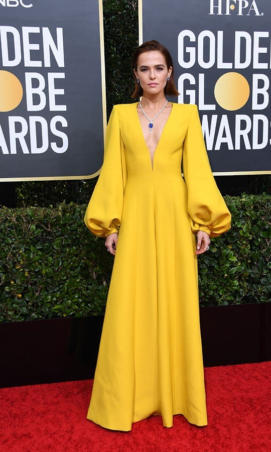 <strong><a href=/tags/0/zoey-deutch>Zoey Deutch</a></strong> was a ray of sunshine in her long-sleeved <a href=/tags/0/fendi><strong>Fendi</strong></a> gown!