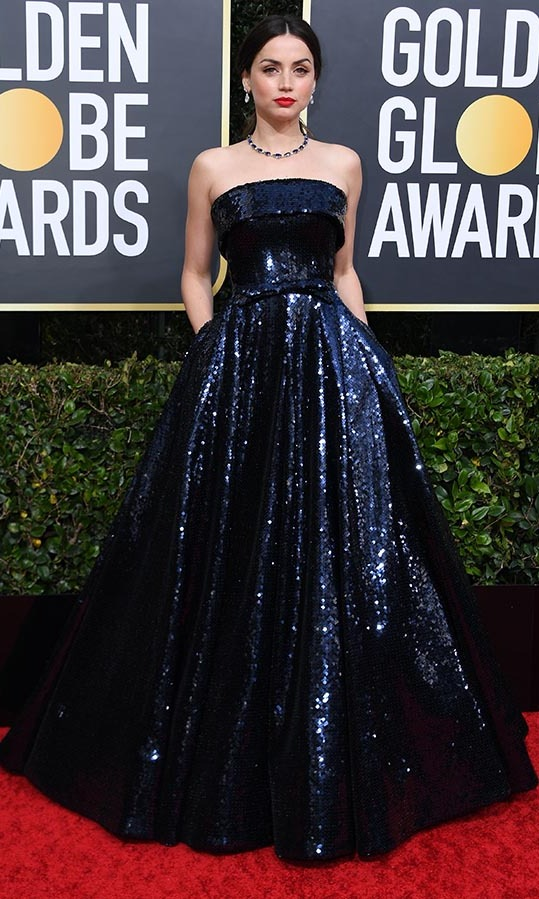 <strong><a href=/tags/0/ana-de-armas>Ana de Armas</strong></a> lit up the red carpet in an inky <a href=/tags/0/ralph-and-russo><strong>Ralph & Russo</a></strong> strapless gown. <p>Photo: &copy; VALERIE MACON/AFP via Getty Images