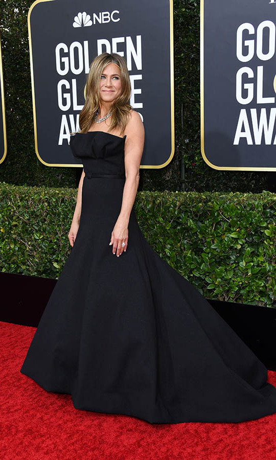 <a href=/tags/0/jennifer-aniston><strong>Jennifer Aniston</strong></a> looked timeless in a strapless black <a href=/tags/0/dior><strong>Christian Dior Haute Couture</strong></a> dress.<p>Photo: &copy; Getty Images