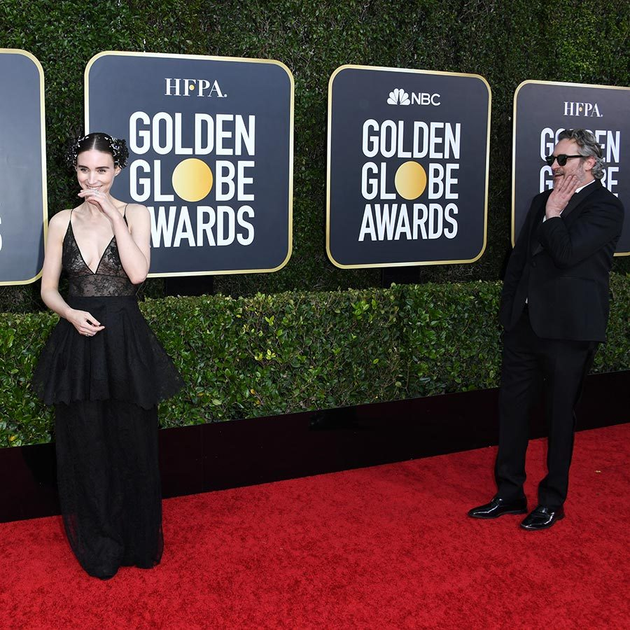 <strong><a href=/tags/0/rooney-mara>Rooney Mara</a></strong> and <Strong><A href=/tags/0/joaquin-phoenix>Joaquin Phoenix</a></strong> couldn't hold back their giggles as they walked the red carpet together.
