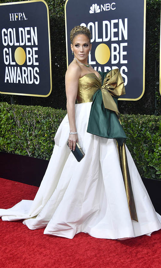 <a href=/tags/0/jennifer-lopez><strong>Jennifer Lopez</strong></a> was all wrapped up in a gold and green bow in a <a href=/tags/0/valentino><strong>Valentino Haute Couture</a></strong> dress!