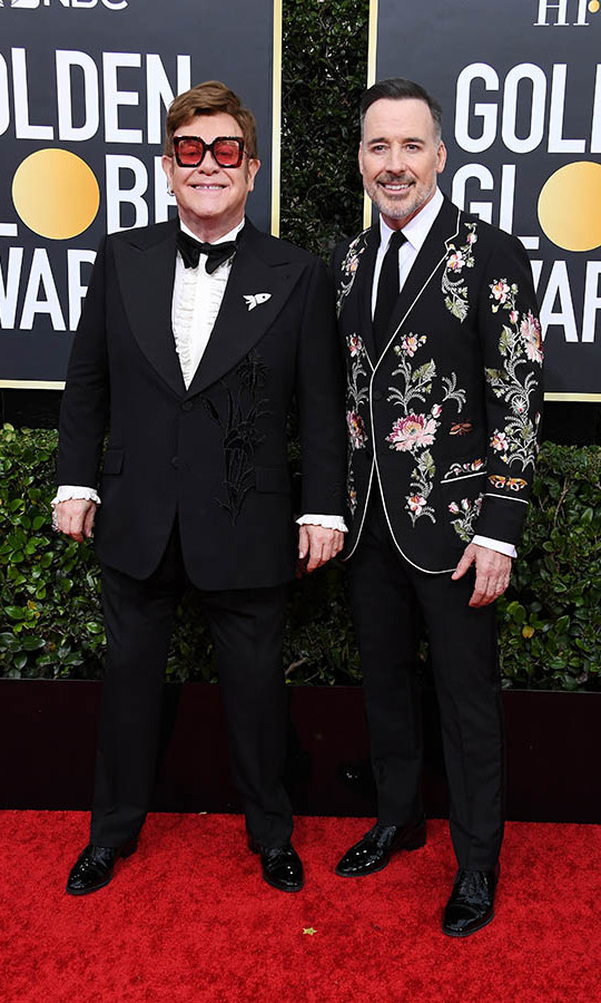 <a href=/tags/0/elton-john><strong>Elton John</strong></a> and <strong><a href=/tags/0/david-furnish>David Furnish</strong></a> were all smiles on the red carpet in their dapper suits!