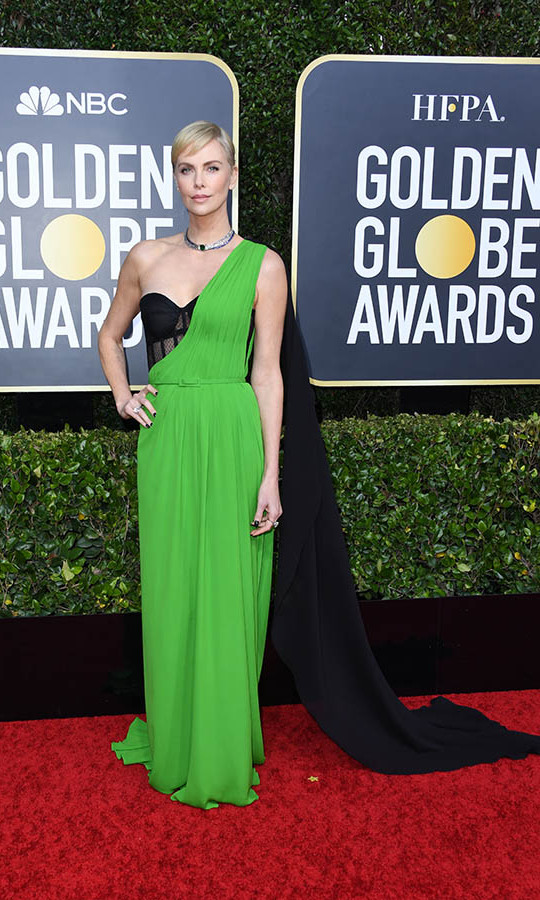 <a href=/tags/0/charlize-theron><strong>Charlize Theron</strong></a> was gorgeous in an electric green <a href=/tags/0/dior><strong>Dior Haute Couture</strong></a> gown with a draped black shoulder. <p>Photo: &copy; Jon Kopaloff/Getty Images