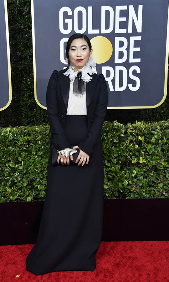 <strong><a href=/tags/0/awkwafina>Awkwafina</strong></a> showed what a serious fashionista she is in a black and white <a href=/tags/0/dior><strong>Christian Dior</a></strong> look with ruffled neckline. <p>Photo: &copy; Frazer Harrison/Getty Images