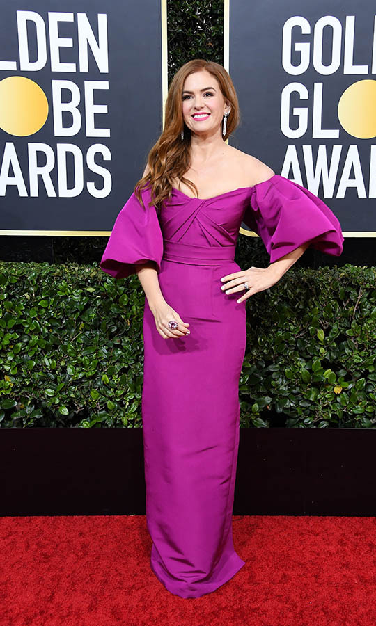 There was no missing <a href=/tags/0/isla-fisher><strong>Isla Fisher</strong></a> in this bold gown with flutter sleeves.